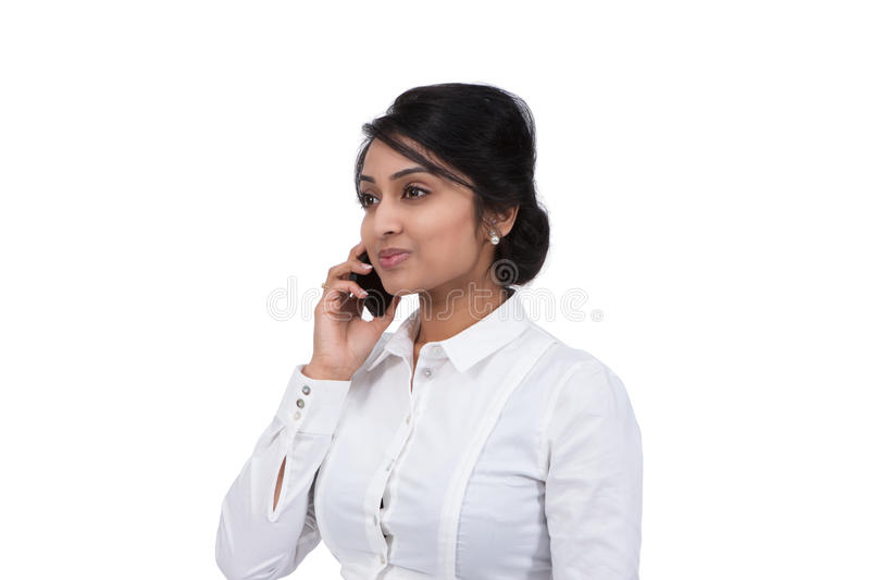 Businesswoman talking on mobile phone stock photography