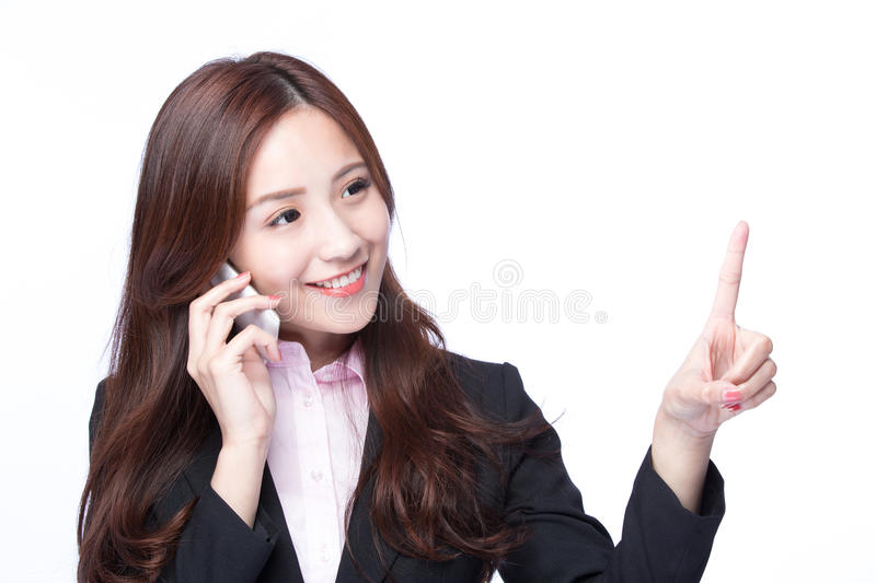 Businesswoman talking on the phone. Young Business woman show empty copy space and smile talking on the mobile phone isolated on white background, model is a stock photography