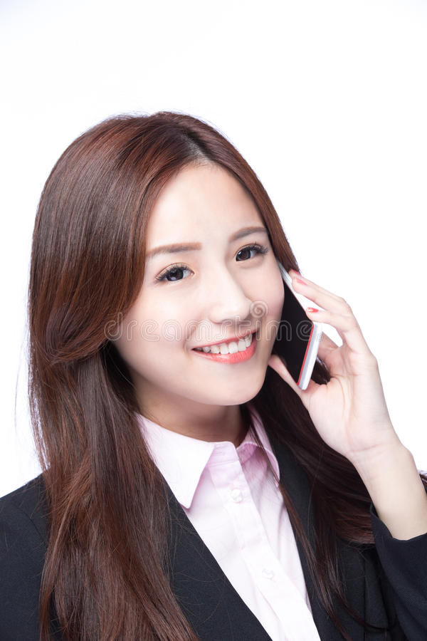 Businesswoman talking on the phone. Young Business woman smile talking on the mobile phone isolated on white background, model is a asian beauty royalty free stock image