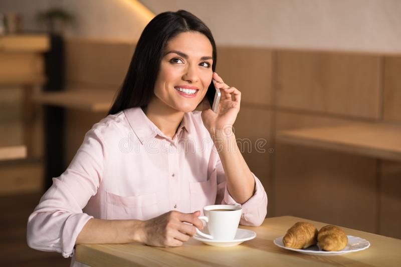 Businesswoman talking on the smartphone. Portrait of smiling businesswoman talking on the smartphone in cafe royalty free stock photos