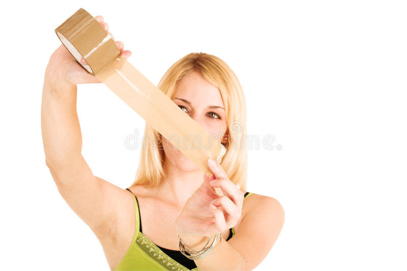 Businesswoman with tape. Blonde businesswoman in an informal green top. Holding a piece of stickytape. Shallow DOF, hands and tape in focus, face out of focus stock photos