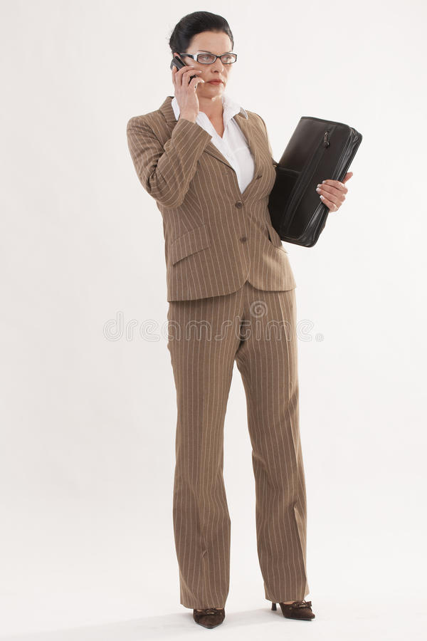 Businesswoman With Telephone And Timer Stock Photo