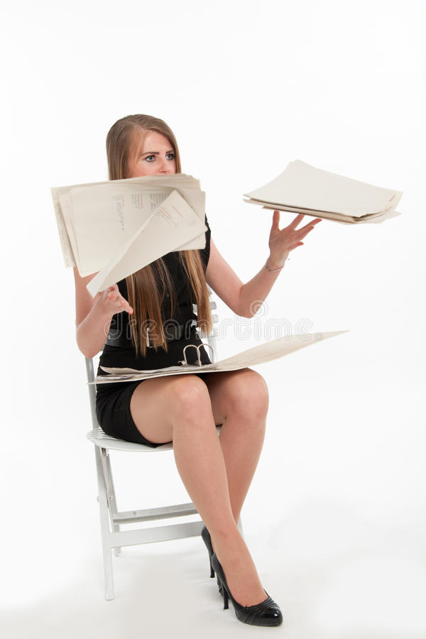 Businesswoman throwing away documents