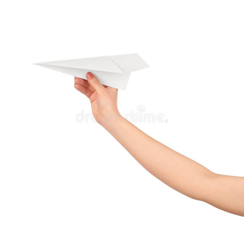 Businesswoman throwing white paper plane. stock photos