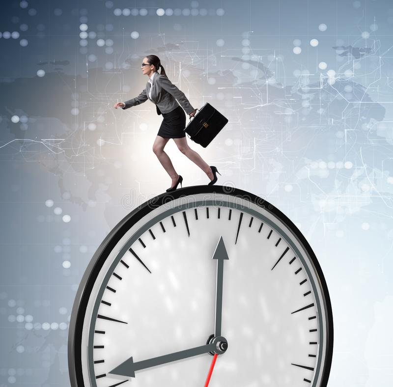 Businesswoman in time management concept. The businesswoman in time management concept stock images