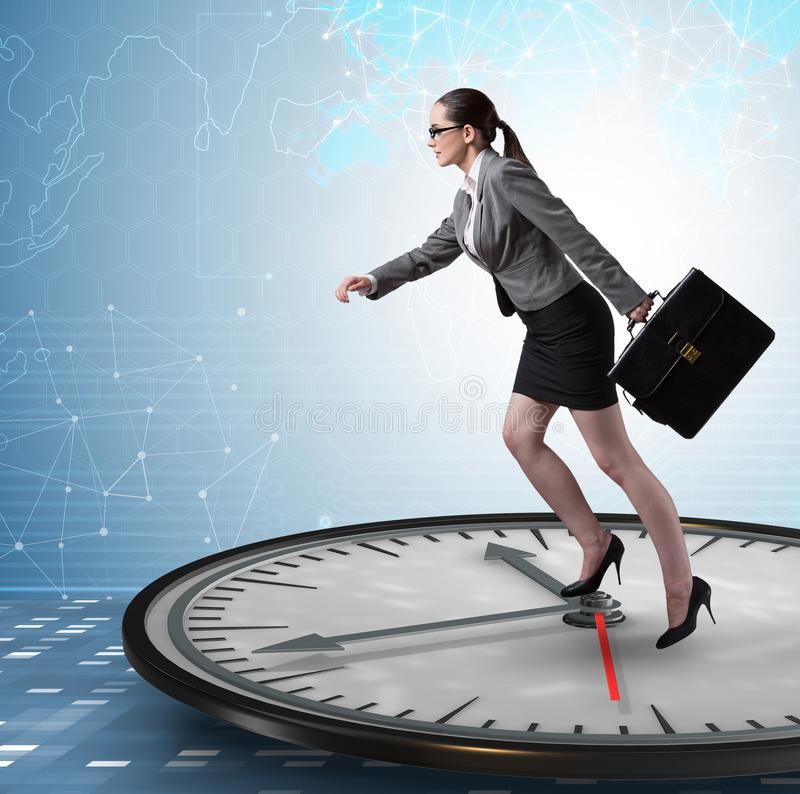 Businesswoman in time management concept. The businesswoman in time management concept royalty free stock photography