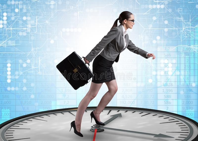 Businesswoman in time management concept royalty free stock photography