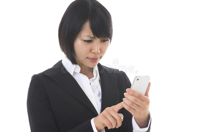 Businesswoman to see a smartphone stock images