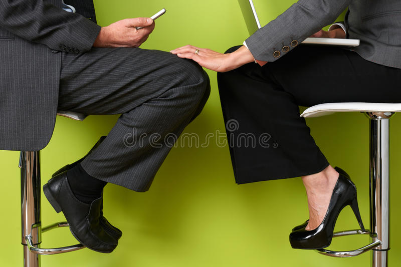 Businesswoman Touching Colleague's Leg royalty free stock image