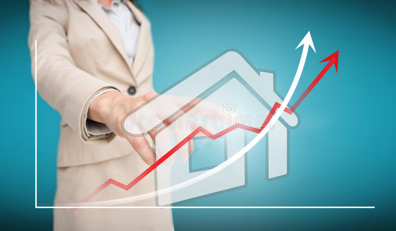 Businesswoman touching futuristic house interface with graph. On blue background stock illustration