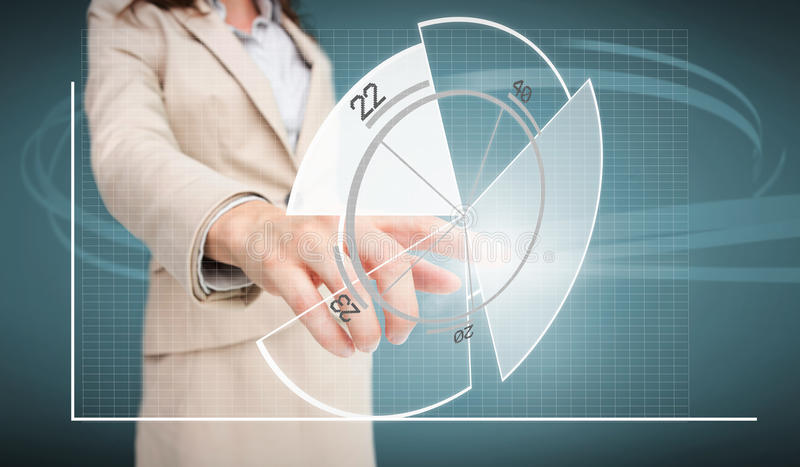 Businesswoman touching futuristic pie chart interface. On blue background royalty free stock image