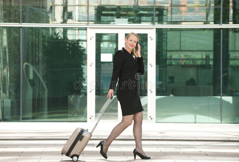 Businesswoman traveling and calling with mobile phone