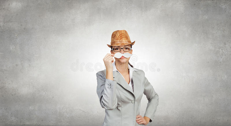 Businesswoman trying paper mustache royalty free stock photography