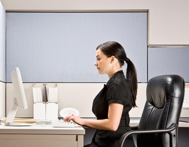 Download Businesswoman Typing On Computer At Desk Royalty Free Stock Photos - Image: 17054998