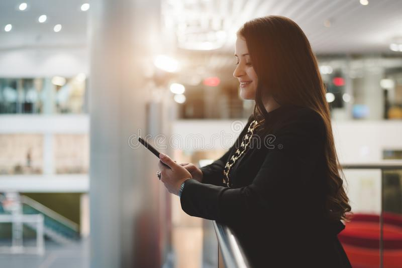A businesswoman using the cellphone stock photography