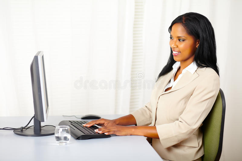 Businesswoman using a computer royalty free stock photos