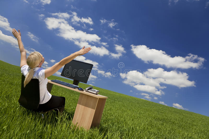 Download Businesswoman Using Computer In A Green Field Stock Photo - Image: 9877702