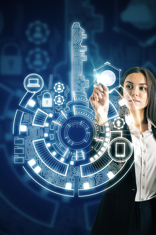 Businesswoman using digital interface. Businesswoman using creative digital key interface on dark background with icons. Access, safety and innovation concept stock photo