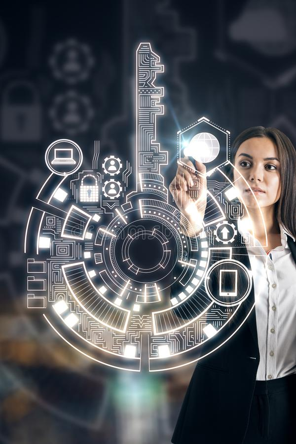 Businesswoman using digital interface. Businesswoman using creative digital key interface on dark background with icons. Access, technology and innovation royalty free stock photos