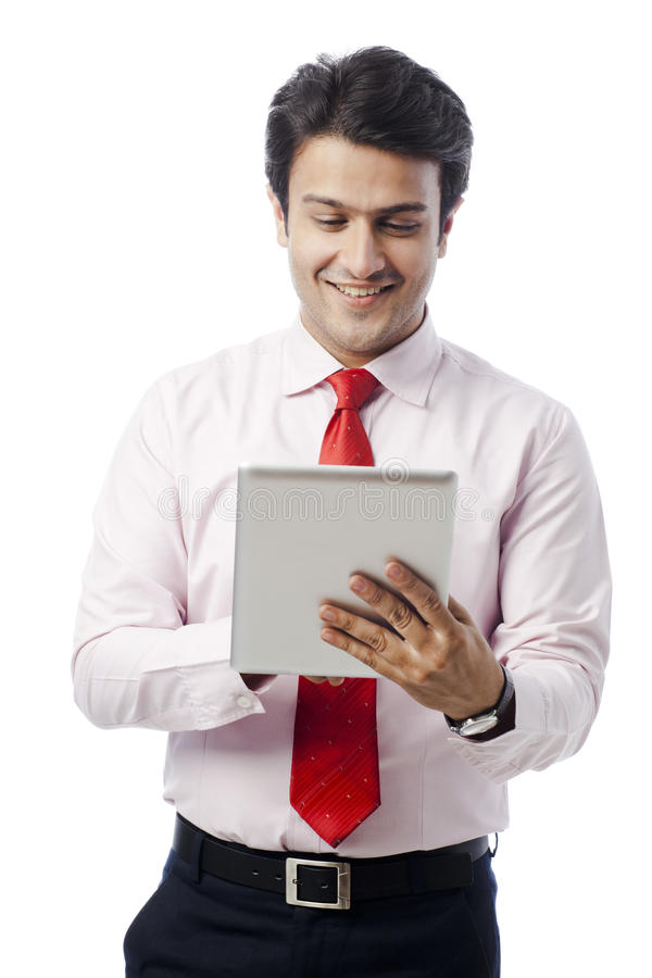 Businesswoman using digital tablet stock photography