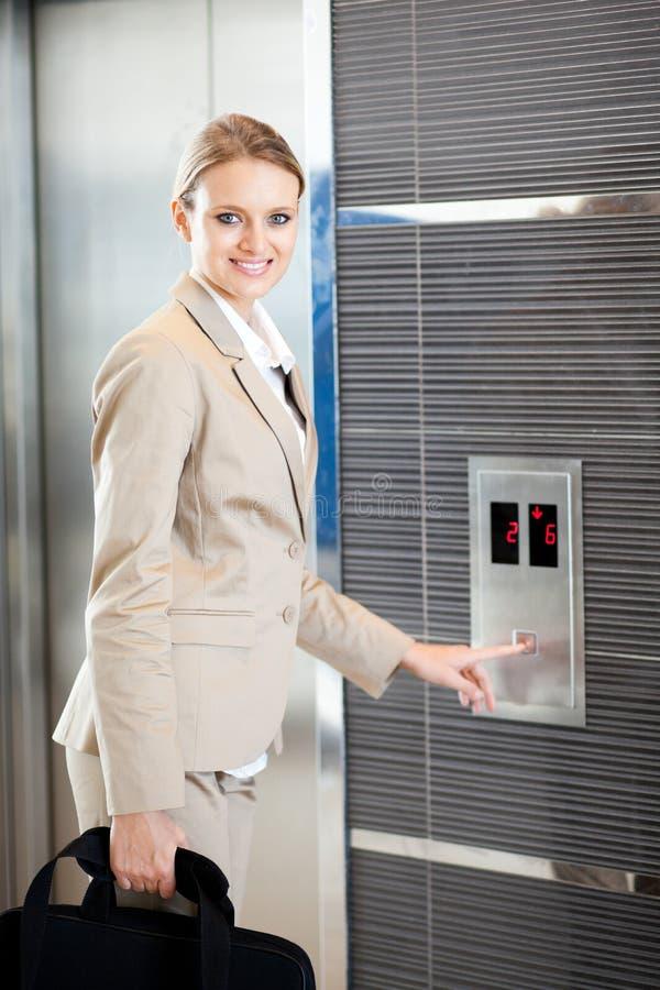 Businesswoman using elevator stock images