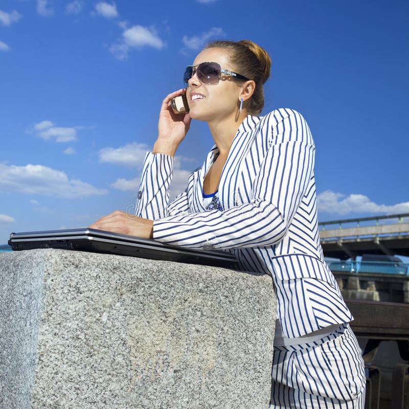 Businesswoman Using Her Mobile Phone Stock Photography