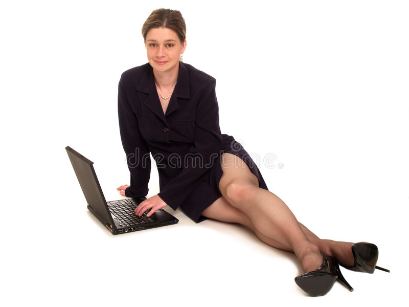 Businesswoman using a laptop royalty free stock images
