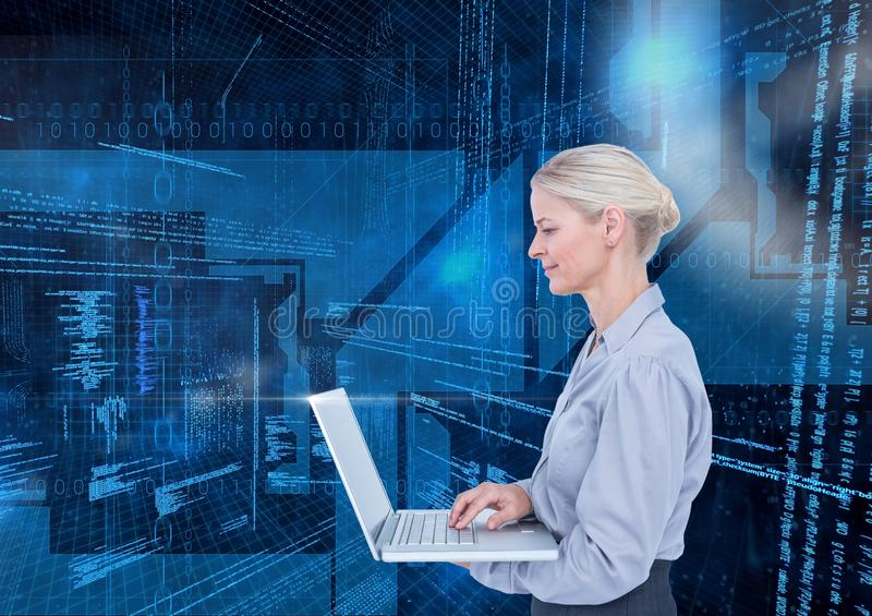 Businesswoman using laptop against binary codes in blue background stock photos