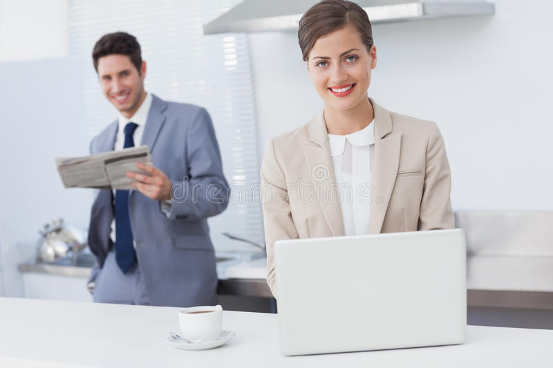 Download Businesswoman Using A Laptop While Having Breakfast Stock Image - Image: 32231555