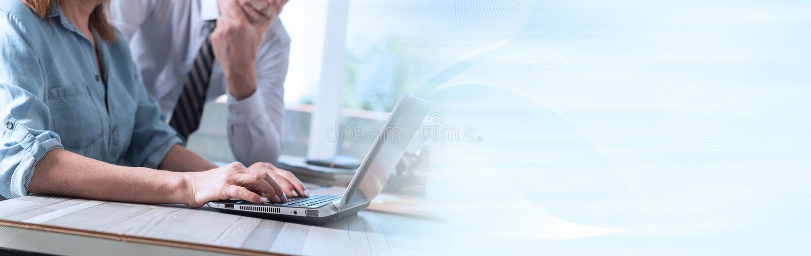 Businesswoman using a laptop; panoramic banner stock photo