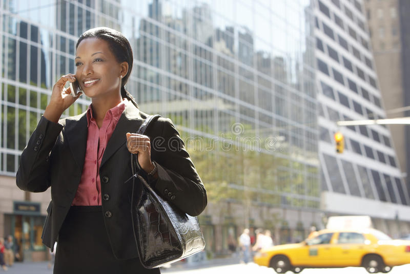 Download Businesswoman Using Mobile Phone On Street Stock Photo - Image: 31836522