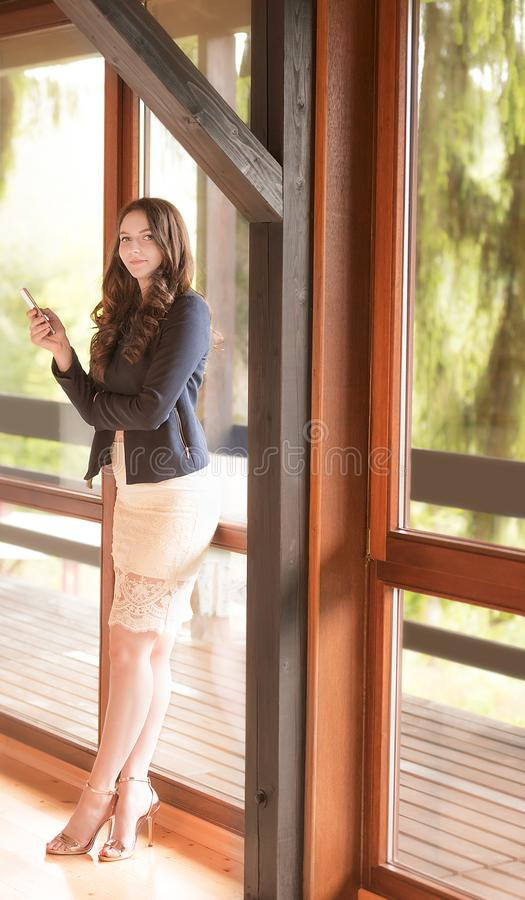 Businesswoman using smart-phone stock photography