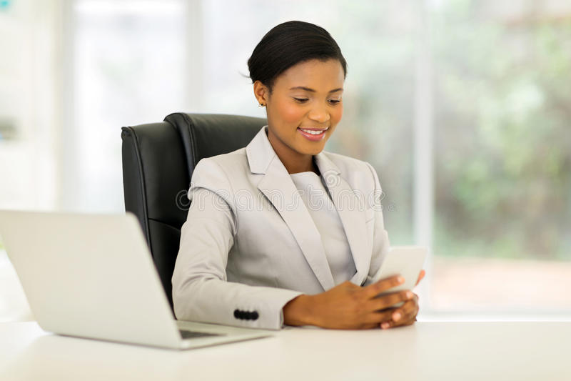 Businesswoman using smart phone stock photos