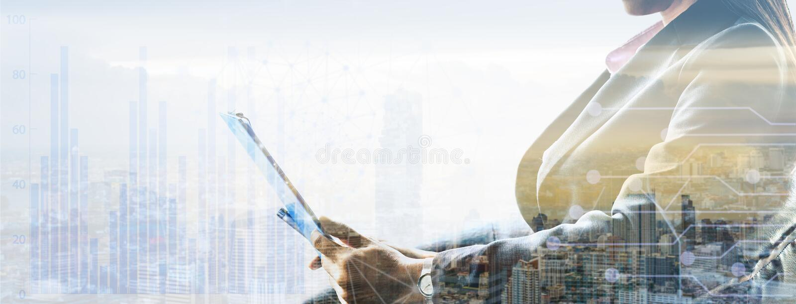 Businesswoman using a tablet stock photography