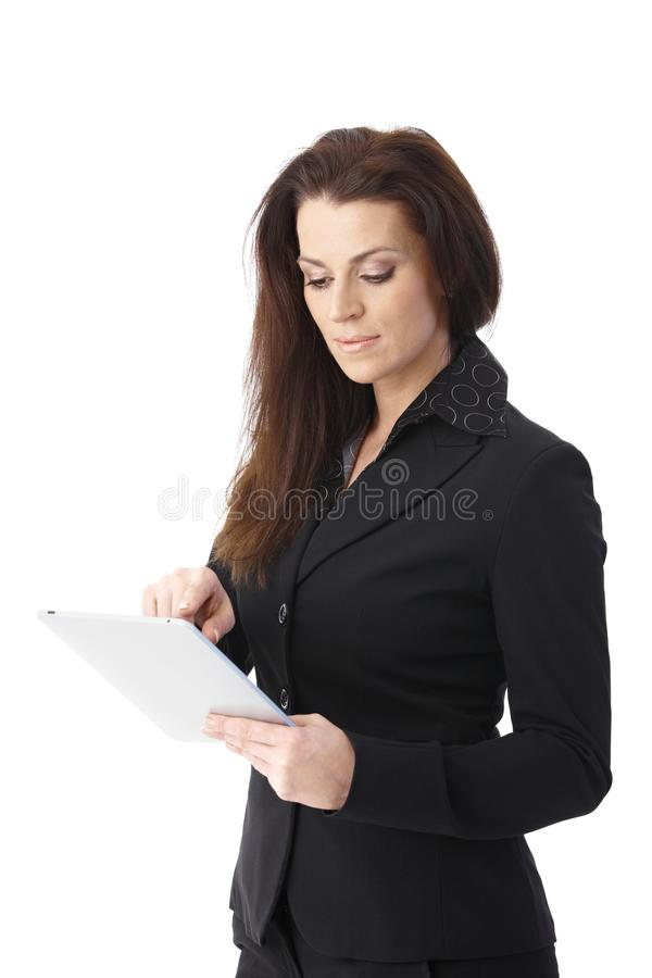 Download Businesswoman Using Tablet Computer Stock Image - Image: 20444987