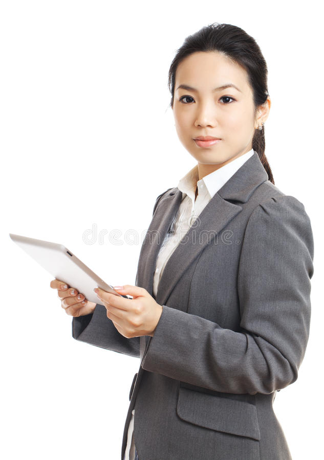 Businesswoman using tablet. Isolated on white royalty free stock images