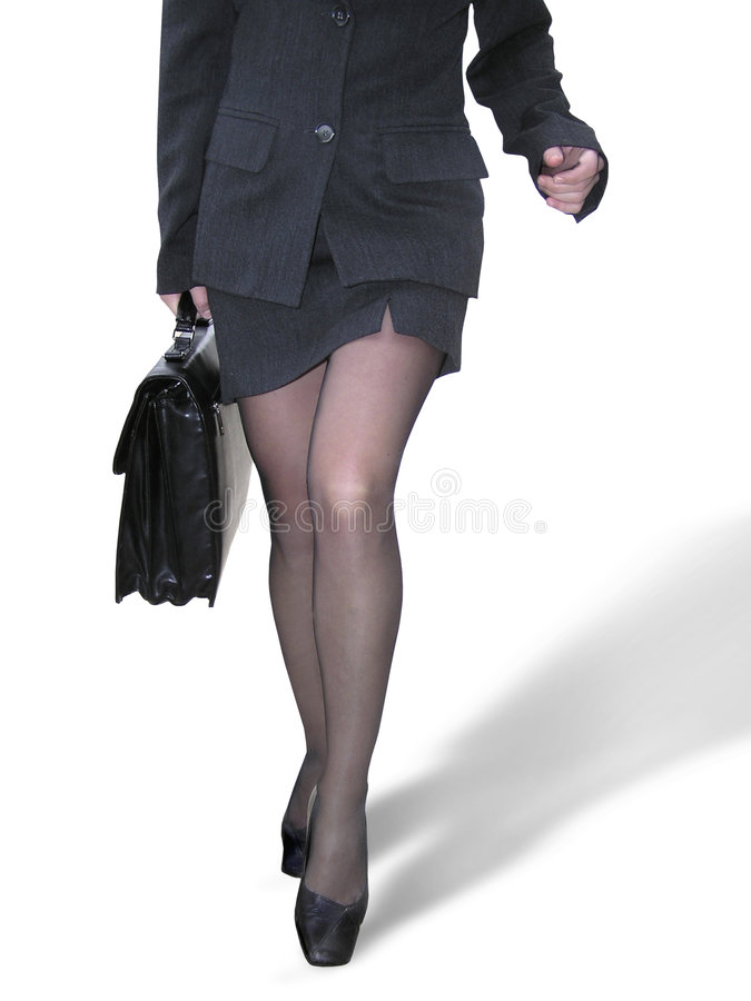 Businesswoman walking. A businesswoman holding a black briefcase walking. Clipping path included royalty free stock image