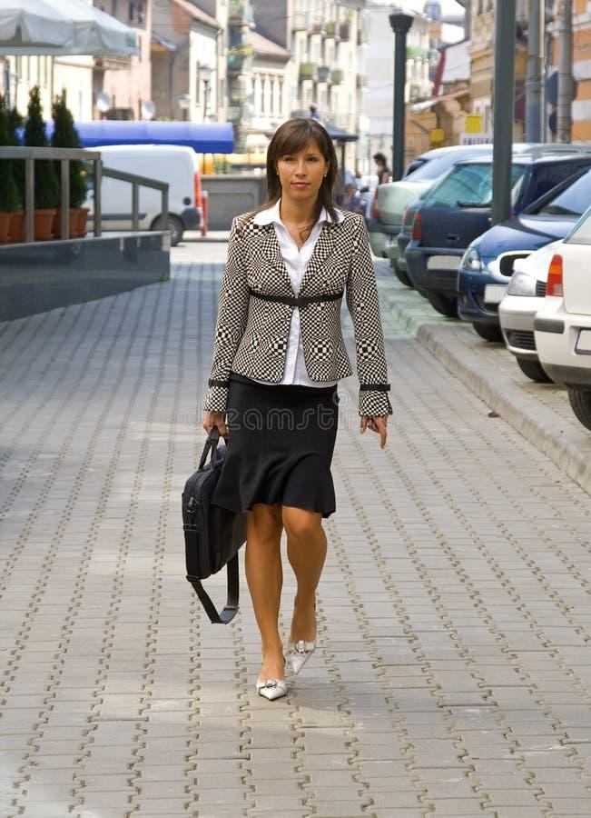 Businesswoman walking royalty free stock images