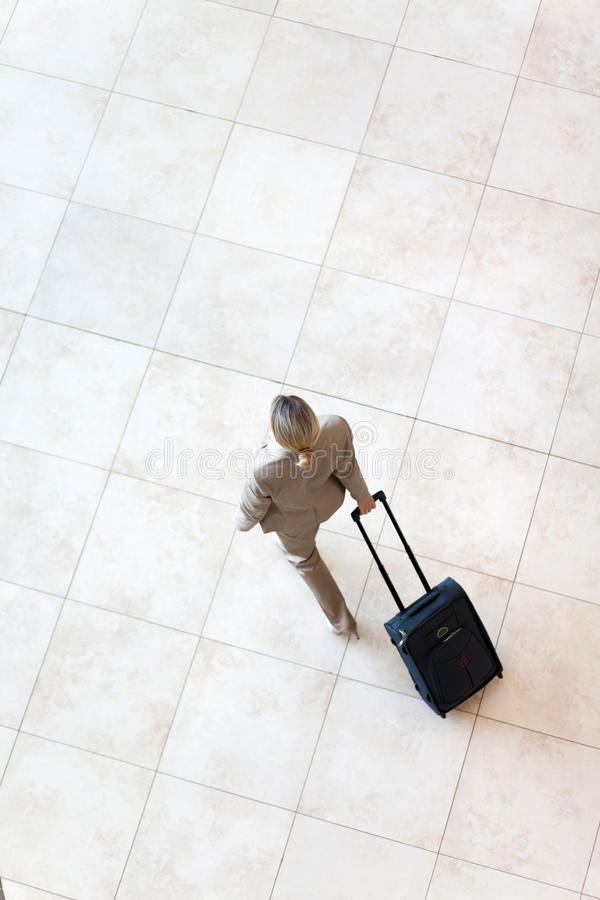 Businesswoman walking airport royalty free stock images
