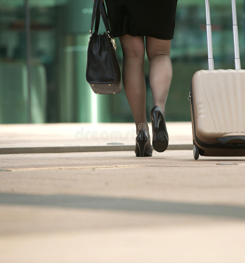 Download Businesswoman Walking With Bag And Suitcase In The City Stock Photo - Image: 32588458