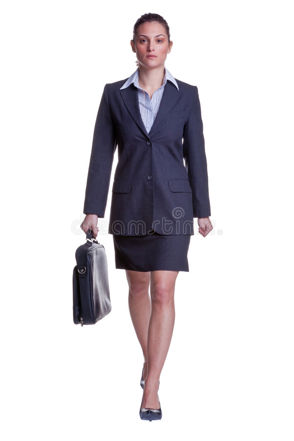 Businesswoman walking with briefcase stock image