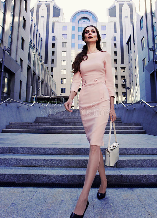 Businesswoman walking in the city stock image