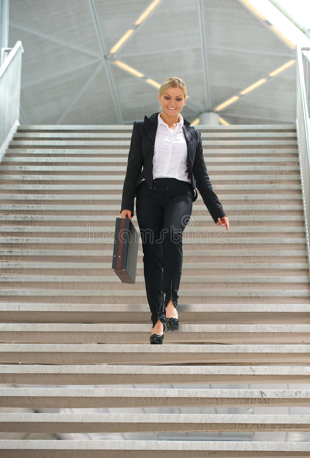 Download Businesswoman Walking Downstairs With Briefcase Stock Image - Image: 32648727