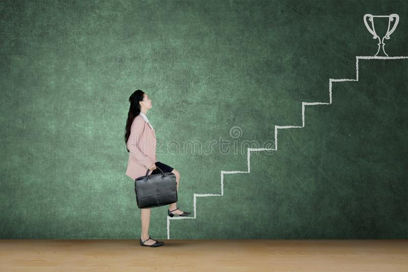 Businesswoman walking on the stairway royalty free stock photos