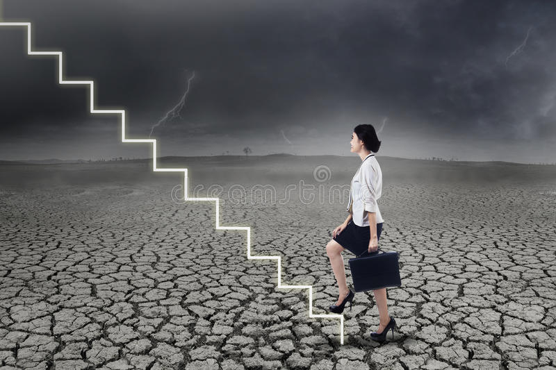 Businesswoman walking up on stairs royalty free stock photos