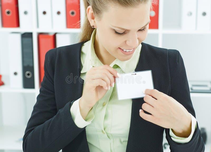 Businesswoman wear blank white badge mockup. royalty free stock photo