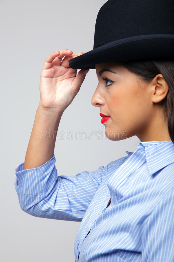 Download Businesswoman Wearing A Bowler Hat. Stock Photo - Image of bowler, businesswoman: 11913378