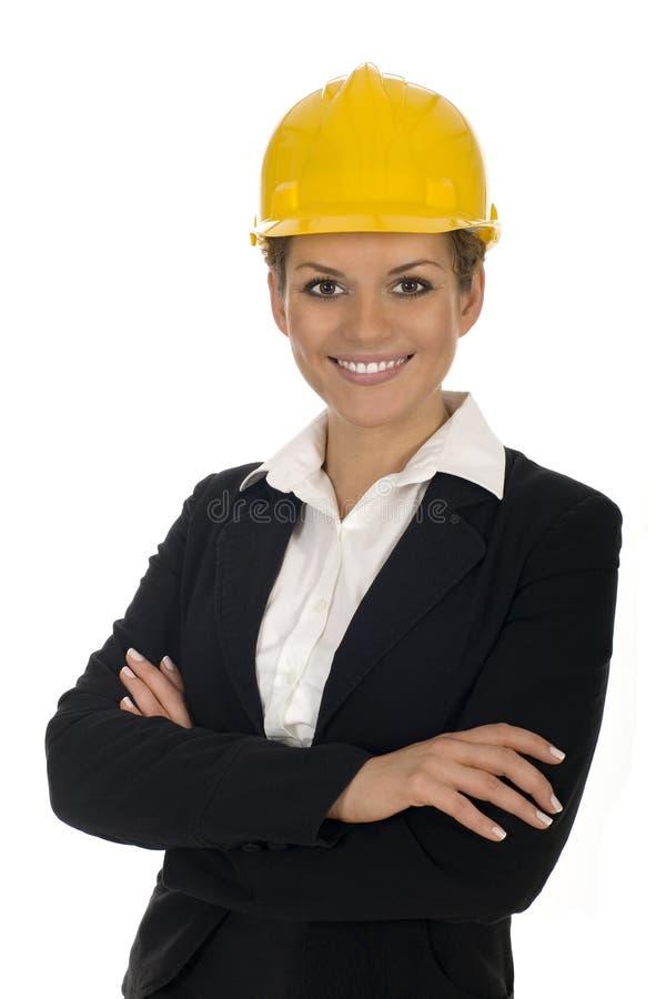 Businesswoman wearing hardhat stock photography