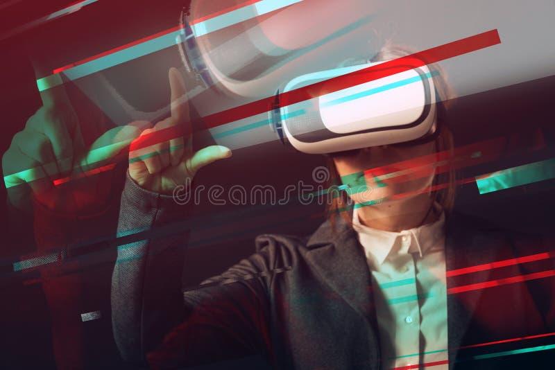 Businesswoman wearing virtual reality headset stock image