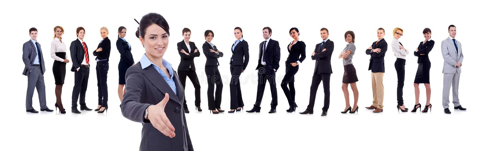 Businesswoman welcoming to her business team stock image